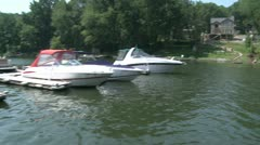 Speed boats docked along the river (1 of 2) Stock Footage