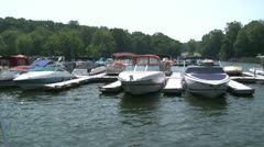 Speed boats docked along the river (2 of 2) Stock Footage