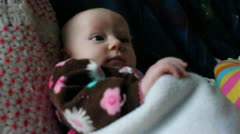 One month old sits happily Stock Footage