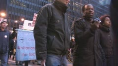 'Unitarian Universities for Social Justice' at Iraq War protest march Stock Footage
