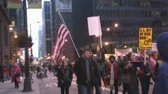 American Flag marcher at Iraq War protest in Federal Plaza - Chicago, IL Stock Footage