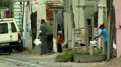 people in the street in a township south africa - stock footage