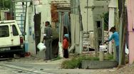 People in the street in a township south africa Stock Footage