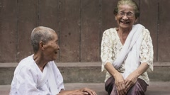 Stock Video Footage of Two old asian women talking and laughing