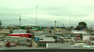 Stock Video Footage of drive past shacks in a township south africa