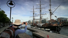 Tourist taking Photo of Potato Famine Ship, Ireland GFHD Stock Footage