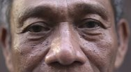 Stock Video Footage of Eyes and face of serious old asian man looking at camera