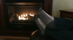 Warm feet in front of fireplace Stock Footage