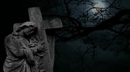 Stock Video Footage of Graveyard statue set against timelapse bare tree and full moon