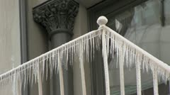 Icicles on the railing - stock footage