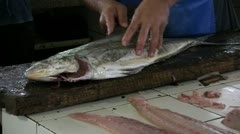 Filleting Fish at Market Stock Footage
