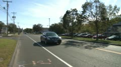 Driving down road outside of town (1 of 2) Stock Footage