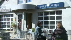 Two women sitting on a cafe patio talking (4 of 4) Stock Footage
