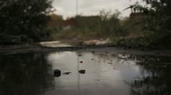 Puddle on a Dark  Overcast Day In Abandoned Lot Stock Footage