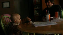 Boy and dad eating Stock Footage