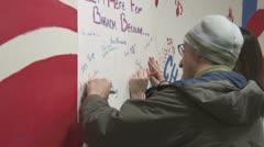 Election volunteers sign poster for Barack Obama Stock Footage