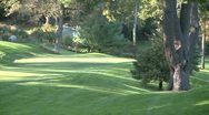 Stock Video Footage of Looking across a hilly area to a putting green
