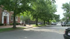 Traffic going through residential area (1 of 2) Stock Footage