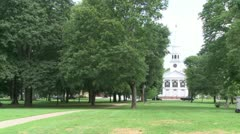 Church across from park with clock on spire (1 of 3) Stock Footage