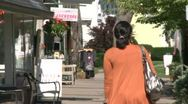 Woman entering a small store Stock Footage