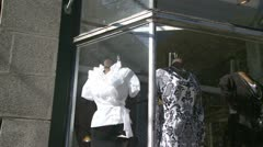Dresses in a store front window Stock Footage