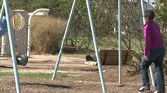 Mother pushing her child on the swing (4 of 4) Stock Footage
