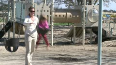 Mother pushing her child on the swing (1 of 4) Stock Footage