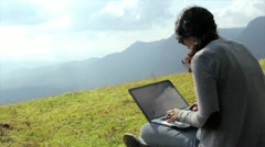 Girl using laptop in mountain - stock footage