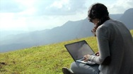 Stock Video Footage of Girl using laptop in mountain