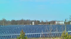 Solar panel field with barn and silo in background Stock Footage
