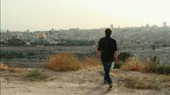 Young pilgrim Walking towards Jerusalem Stock Footage