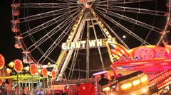Giant Carnival Fairground Wheel from below Stock Footage