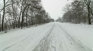 Car driving on  snowy country road Stock Footage