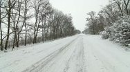 Car on a country road in winter Stock Footage
