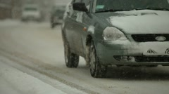 Traffic moving slow through a snow Stock Footage