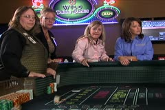Long Shot of Woman Rolling Dice at Craps Table Stock Footage