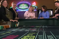 Woman Rolling Dice at Craps Table - stock footage