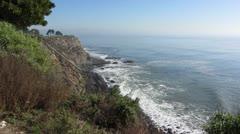 Crashing Waves Against Beautiful Shoreline Bluff Stock Footage