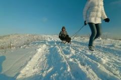 Pulling Sledge Through Winter Landscape Stock Footage