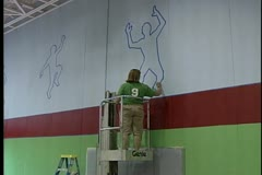 Outlining Poses on Wall for Gym Make-over Stock Footage