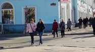 Stock Video Footage of PETROZAVODSK, RUSSIA -April, 13: Pedestrians crossing Gertsen street in the