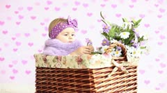 Little girl siting in a basket Stock Footage