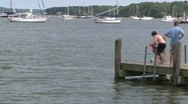 Stock Video Footage of Kids jump off pier into water (3 of 3)