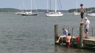 Stock Video Footage of Kids jump off pier into water (1 of 3)