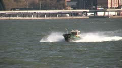 Small Motor Boat on New York waterway Stock Footage