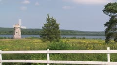 Windmill near the water - stock footage