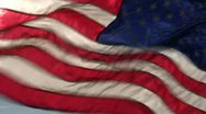 Slow motion Back-lit American flag flying strong Stock Footage