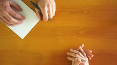 Price Negotiation on a Wood Table Stock Footage