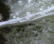 Great CLOSE UP Frazil Ice then ZOOM OUT Ice Breaks off in River GFSD Stock Footage