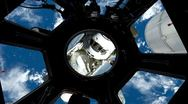 The Space Shuttle floats into view at the International Space Station (ISS) Stock Footage